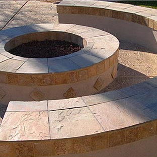 Photo of a modern partial sun backyard stone landscaping in Atlanta with a fire pit.