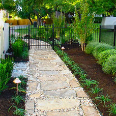 Traditional Landscape by GreenScapes Landscaping & Pools