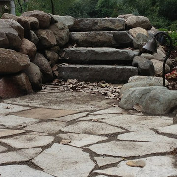 Flagstone patio with boulder wall