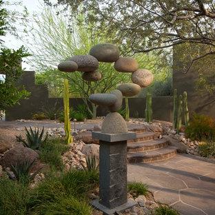 Foto de jardín de secano, contemporáneo, en patio trasero, con adoquines de piedra natural