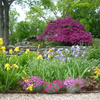 Design ideas for a huge traditional full sun backyard gravel landscaping in New York for spring.
