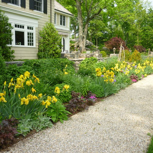 This is an example of a huge traditional full sun backyard gravel landscaping in New York for spring.