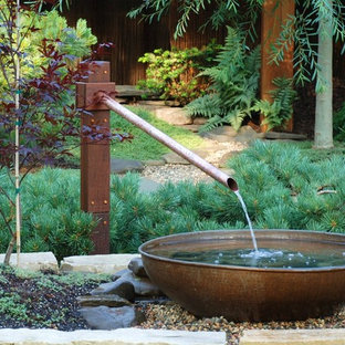 Photo of a small asian partial sun side yard gravel landscaping in Minneapolis for summer.