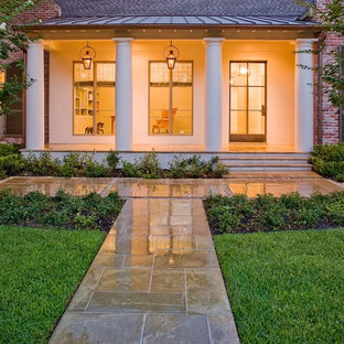 Inspiration for a mid-sized traditional full sun front yard concrete paver garden path in Houston for fall.