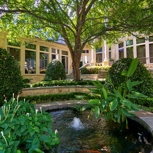 Inspiration for a traditional backyard water fountain landscape in Dallas.