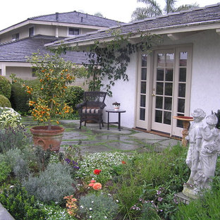 Design ideas for a large traditional full sun front yard stone outdoor sport court in Orange County.