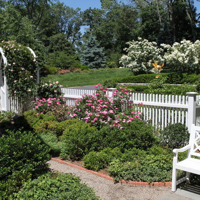 Photo of a large traditional full sun backyard stone formal garden in New York.