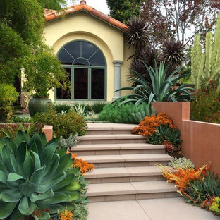Inspiration for a mediterranean front yard full sun garden in San Diego with concrete pavers.