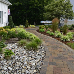 Inspiration for a large traditional partial sun backyard stone garden path in DC Metro for spring.
