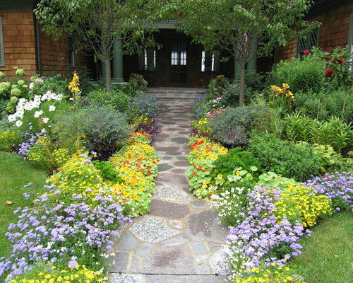 Photo Of A Traditional Front Yard Garden For Summer In Minneapolis With  Natural Stone Pavers.