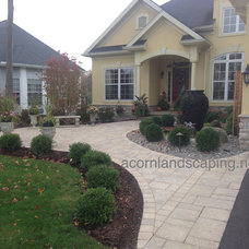 Traditional Landscape by Acorn Landscaping and Ponds LLC