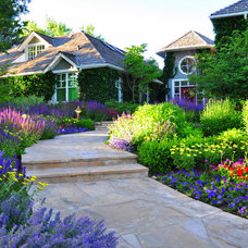 Traditional Landscape by Designscapes Colorado Inc.