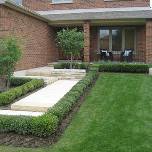 Photo of a small modern full sun front yard stone landscaping in Toronto for summer.