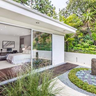 Idées déco pour un jardin sur toit contemporain de taille moyenne avec un foyer extérieur.