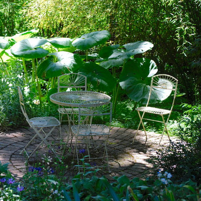 Inspiration for a mid-sized eclectic shade backyard brick formal garden in Seattle for summer.