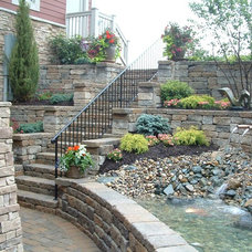 Traditional Landscape by Environmental Management, Inc.