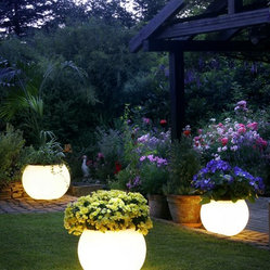 Garden Lighting - These garden pots light up the evening yard and are certain to spark conversation.