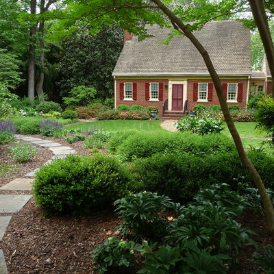 Photo of a large traditional front yard stone landscaping in Richmond.