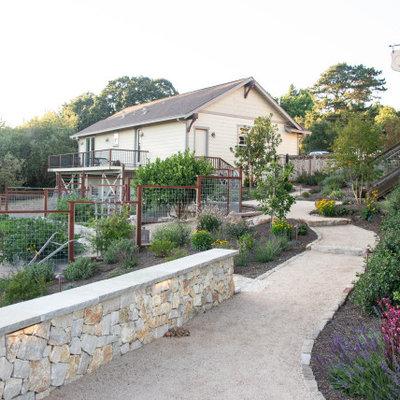 Design ideas for a large traditional full sun backyard gravel vegetable garden landscape in San Francisco.