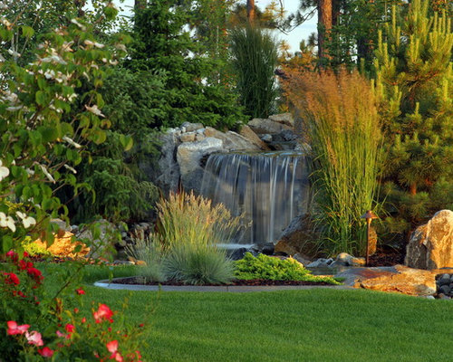 Waterfall Landscape Design Ideas best backyard and terraces landscaping design ideas small pond with waterfall garden art ornaments stone borders green garden grass brown wooden fences Design Ideas For A Traditional Landscape In Seattle With A Water Feature
