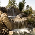 Boulder retaining walls rustic landscape grand for Landscaping rocks grand rapids mi