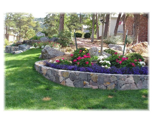 Front yard retaining wall ideas houzz inspiration for a mid sized traditional full sun front yard mulch retaining wall landscape in workwithnaturefo