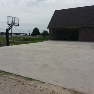 Design ideas for a large traditional partial sun front yard outdoor sport court in New Orleans.