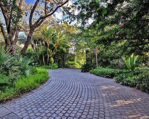 inspiration for a tropical stone driveway in miami - Cobblestone Pavers