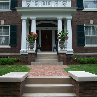 Design ideas for a mid-sized traditional full sun front yard brick landscaping in Chicago for spring.