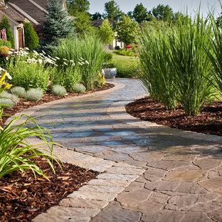 This is an example of a mid-sized traditional front yard concrete paver garden path in Milwaukee.