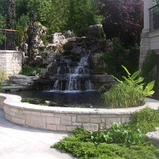 Traditional Landscape by Gib-San Pools Ltd.