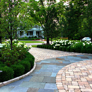 This is an example of a traditional front yard brick driveway in Chicago.
