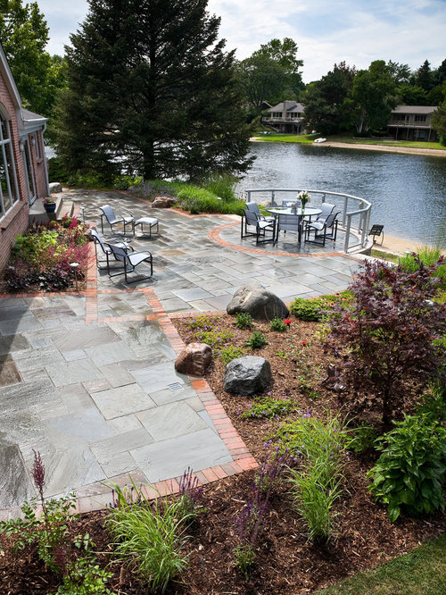 This Is An Example Of A Mid Sized Contemporary Full Sun Backyard Stone  Landscaping In