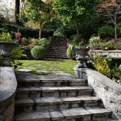 Inspiration for a traditional hillside stone landscaping in Montreal.