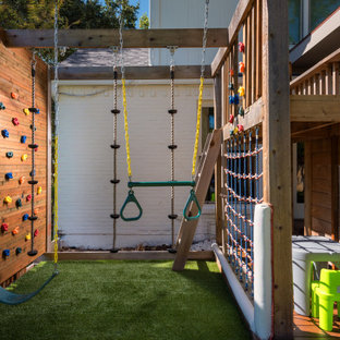 This is an example of a mid-sized transitional backyard outdoor playset in Dallas with decking.