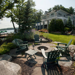 Design ideas for a huge traditional full sun backyard landscaping in Boston with a fire pit for summer.