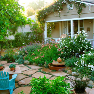 Inspiration for a mid-sized traditional front yard stone landscaping in Santa Barbara.