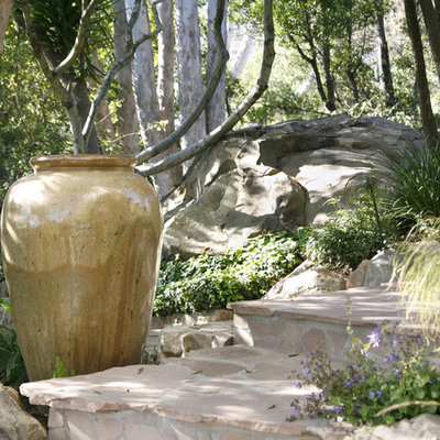 Inspiration for a mid-sized eclectic backyard stone landscaping in Santa Barbara.
