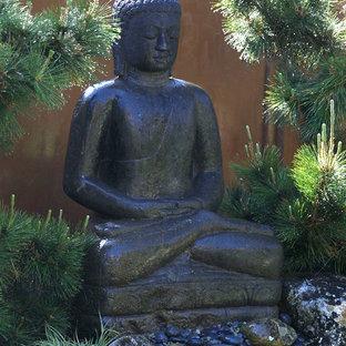 Photo of a mid-sized asian backyard formal garden in Santa Barbara.