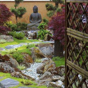 Design ideas for a mid-sized asian partial sun backyard stone landscaping in Santa Barbara.