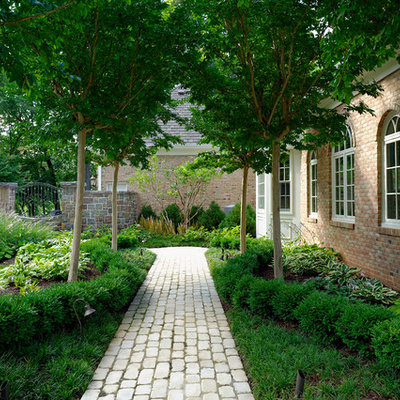 This is an example of a mid-sized traditional side yard brick garden path in DC Metro.