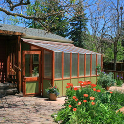 Greenhouse Retreat - A 120 sq ft year-round greenhouse, attached to an artists studio. The perfect place for relaxing, growing and well, just breathing. Cedar raised garden beds, polycarbonate roofing, automated vents, and passive heating / cooling system.