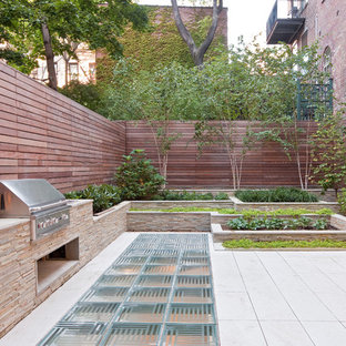 This is an example of a contemporary backyard landscaping in New York.