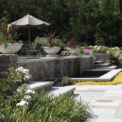 traditional landscape by Natchez Stone Company, LLC.