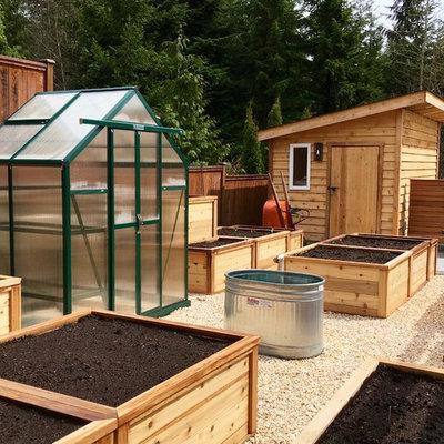 Inspiration for a large modern full sun backyard gravel vegetable garden landscape in Vancouver.