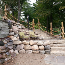 Traditional Landscape by Stoney Brook Landscaping