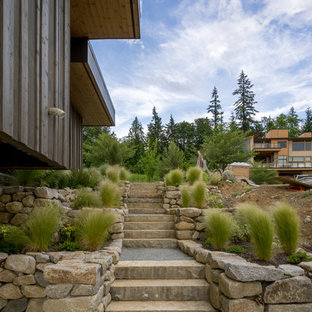 Design ideas for a traditional partial sun hillside stone landscaping in Seattle.