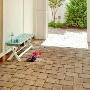 Inspiration for a coastal brick landscaping in New York.
