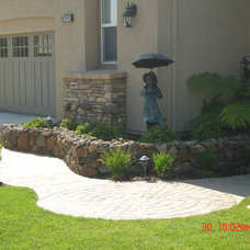 Traditional Landscape by All Access Construction