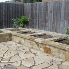 Traditional Landscape by Ravenscourt Landscaping and Design LLC